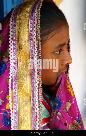 Vividly colorful traditional dress of a Tribal girl in a Banni Village in Gujarat - Stock Photo