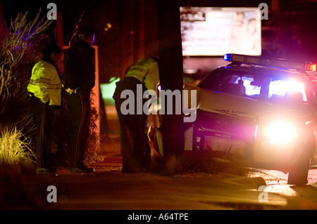Police car wsrecked in to telephone near Uchi, a Sushi restaurant on South Lamar in Austin TX. - Stock Photo