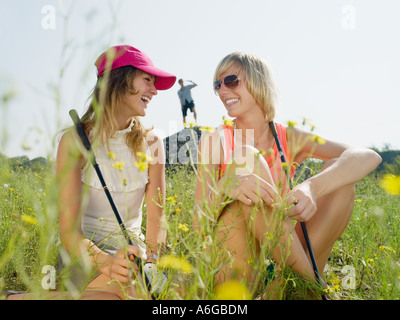 Young female golfers laughing - Stock Photo