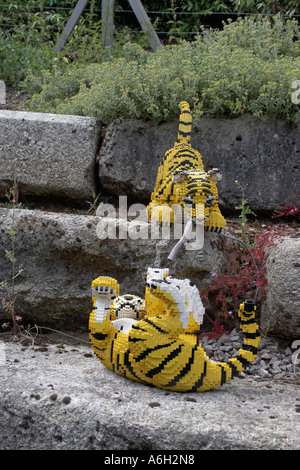 Lego tiger figures on Orient Expedition steam engine train ride in Legoland - Stock Photo