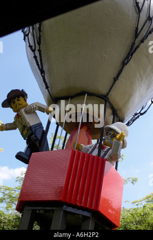 Lego balloonist figures on Orient Expedition steam engine train ride in Legoland - Stock Photo