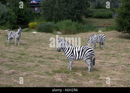Lego zebra figures on Orient Expedition steam engine train ride in Legoland - Stock Photo