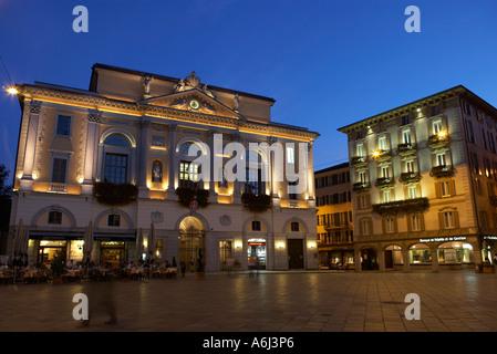 The lit historical city hall to the Piazza della Riforma in the evening, Lugano, Switzerland - Stock Photo