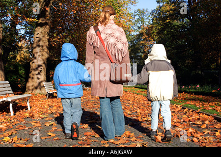 Mother taking a walk with her children, Berlin, Germany - Stock Photo