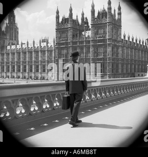 Englishman in bowler hat on Westminster bridge with Houses of Parliament - Stock Photo