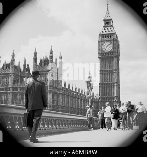 Englishman in bowler hat on Westminster Bridge with Houses of Parliament and Big Ben - Stock Photo