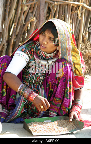 Vividly colorful dress of a Meghwal BhirindiyaraTribal girl in a Banni Village,Gujarat - Stock Photo