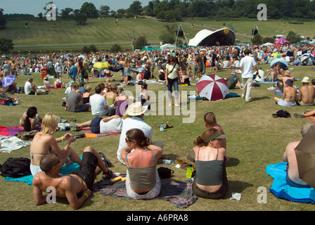 Festival goers relaxing in front of the main stage at the Big Chill music and dance festival, Eastnor Castle, Herefordshire - Stock Photo