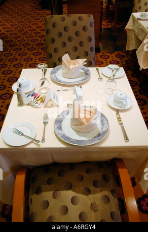 Dining room with prepared tables aboard the Cruise Ship - Stock Photo