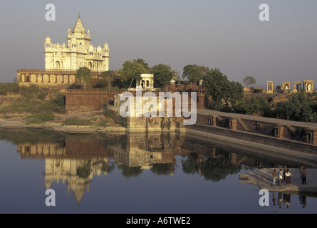 ASIA, India, Jodphur, Rajasthan, Temple reflection, with locals on shoreline - Stock Photo