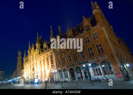 Horizontal wide angle view of the Provincial Court in the Markt [Market Place] illuminated at night. - Stock Photo