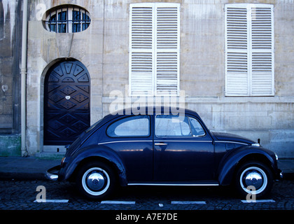 Blue Vintage Volkswagen Beetle parked on Quai de Bourbon Ile St Louis Paris - Stock Photo
