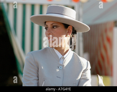 Portait of an elegant young woman in traditional dress riding through the April Fair - Feria de Abril - Seville, - Stock Photo