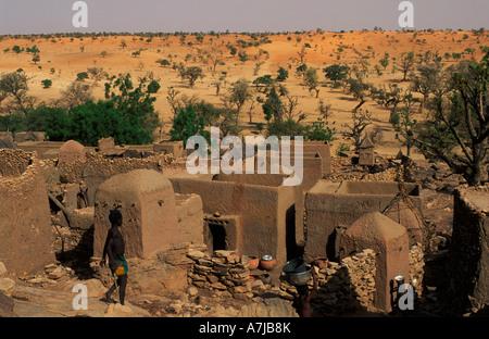 Cliff village built on the slopes of the Bandiagara escarpment, view over desert plains, Tireli, Dogon Country, - Stock Photo