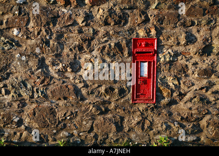 Victorian post box in a rough stone wall Wales UK - Stock Photo