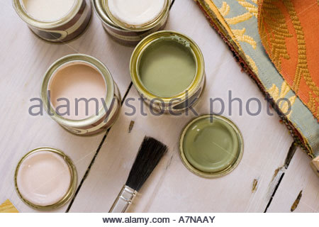 Small tins of paint on floor close up overhead view still life - Stock Photo