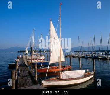 Boats at harbor Lake Chiemsee Bavaria Germany - Stock Photo