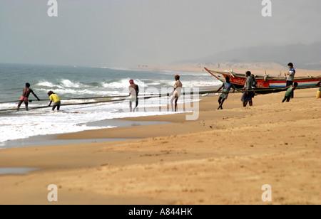 Traditional fishing and boats on Puri Beach,Orissa India - Stock Photo