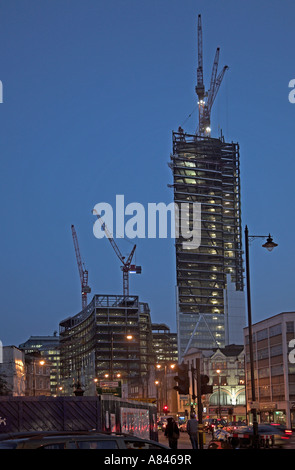 Bishopsgate and The Broadgate Tower under construction huge cranes  from Shoreditch High Street, London East End, - Stock Photo