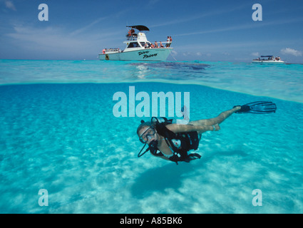 Turks Caicos Providenciales Provo Northwest Point shallows under over view of woman scuba diver swimming away from - Stock Photo