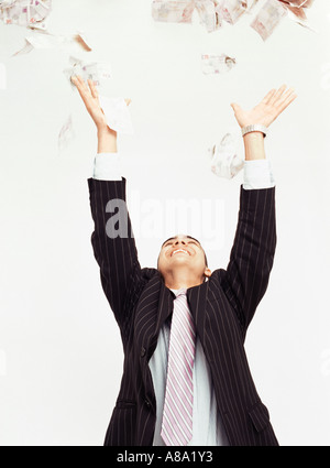 Businessman throwing money in air - Stock Photo