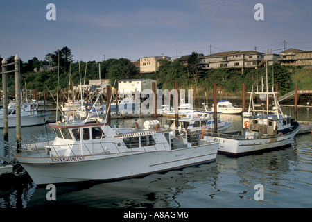 Commercial fishing boats docked in the world s smallest natural navigable harbor at Depoe Bay Oregon Coast - Stock Photo