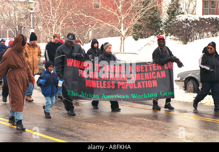 Martin Luther King Day MLK March carrying banner for the homeless St Paul Minnesota USA - Stock Photo