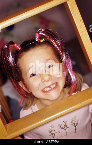 GIRL WITH MISSING TOOTH, IN PIG TAILS - Stock Photo