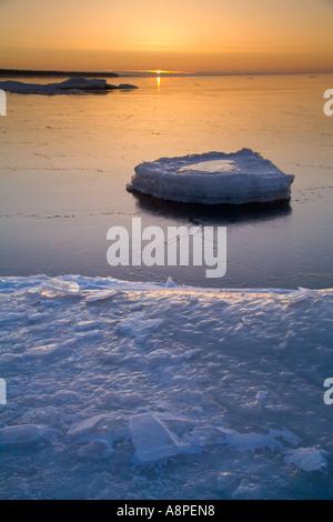 Winter Sunrise on the Manistique Shore - Stock Photo