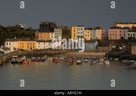 colourful georgian houses at sunset Tenby harbour and north beach Pembrokeshire west wales - Stock Photo
