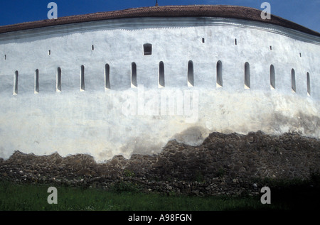 Massive white wall that surrounds the Saxon fortified church in Prejmer (Transylvania) Romania. - Stock Photo