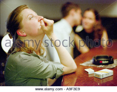 Young Lonely Woman at The Bar Desk - Stock Photo