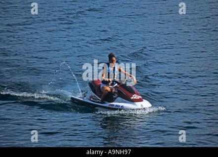 CHELAN WASHINGTON STATE USA August Young girl riding a powerful jet ski on Southern Lake Chelan - Stock Photo