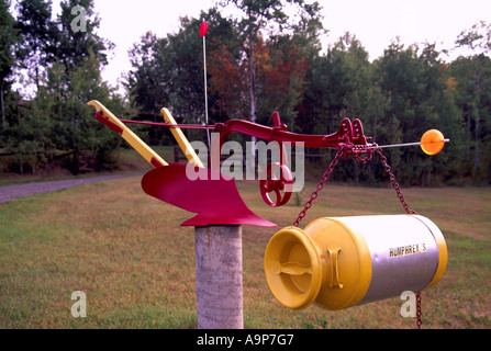 Recycling Plow and Milk Can into Unusual Whimsical Artistic Folk Art Mailbox - Recycled Products and Materials - Stock Photo