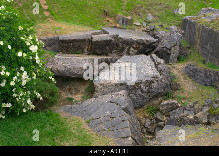 Remains of German bunker after heavy bombing at Pointe du Hoc Normandy France - Stock Photo
