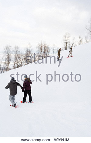 Couples walking in snow - Stock Photo