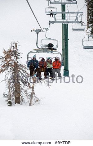 Skiers on a ski lift - Stock Photo