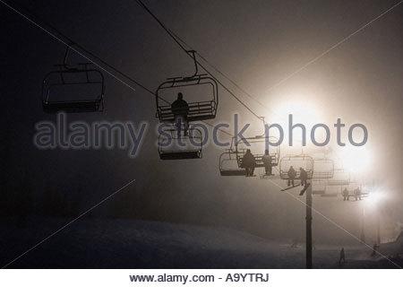 Skiers on a ski lifts - Stock Photo