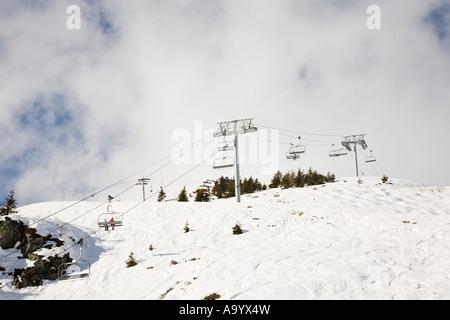 Skiers on ski lift - Stock Photo