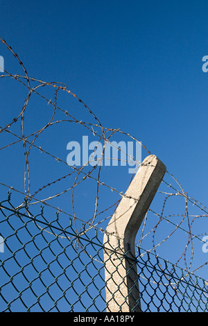 Barbed and razor wire on a fence - Stock Photo