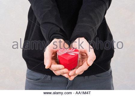 Man holding a heart shaped box - Stock Photo