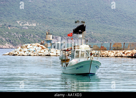 A Turkish fishing boat returns to port in Kas in Southern Turkey - Stock Photo