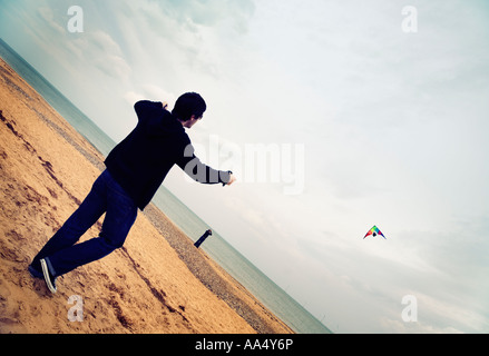 Kite flying on the beach at Caister on Sea Norfolk England - Stock Photo