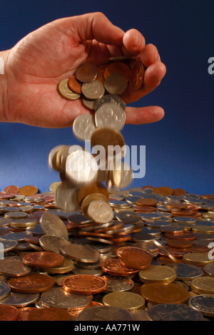 Pouring out money from a hand - Stock Photo