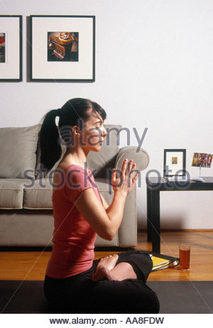 Woman in yoga pose - Stock Photo