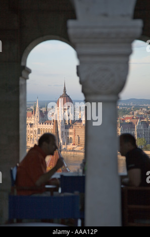 Hungarian Parliament building seen through the Fishermen Bastion Budapest - Stock Photo