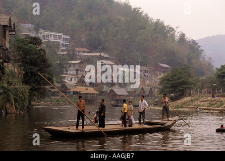 Ferry on the Mae Sai River the border between Thailand and Myanmar Burma - Stock Photo