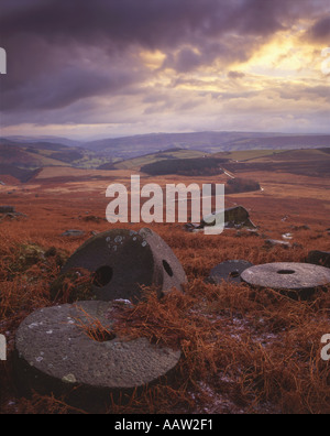 Abandoned millstones beneath Stanage Edge Peak District National Park Derbyshire - Stock Photo