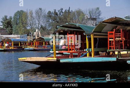 Boats in the floating gardens of Xochimilco, Mexico City. - Stock Photo