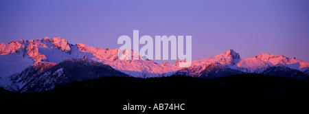 Alpenglow on the 'Tantalus Range' near Whistler British Columbia Canada - Stock Photo